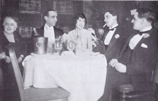 A candid photo of the dancers Moss and Fontana with there guests at the Acacias Nightclub, Paris, 1920s