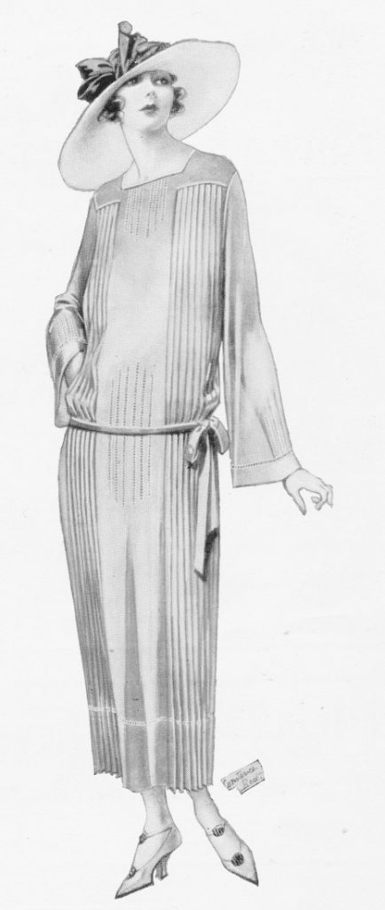 A frock in rust coloured voile adorned by pleats and drawn thread work, from the London couture house of Zorene Ltd, 1922