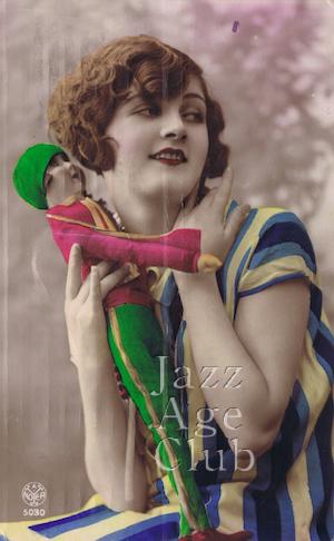 A girl with her boudoir doll, Paris, 1920s