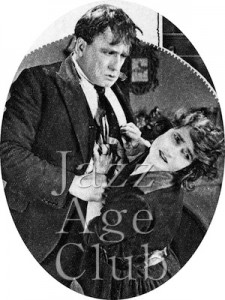 Henry Watson, the chauffeur (Herbert Langley) bullying his wife Kate (Hilda Bayley) in The Flames of Passion (1922)