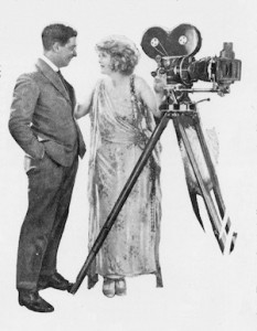 Mae Marsh with the cameraman on the set of Flames of Passion (1922)