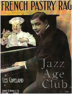 Les Copeland playing piano on the sheet music for French Pastry Rag