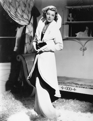 Myrna Loy in a Dolly Tree gown in Evelyn Prentice
