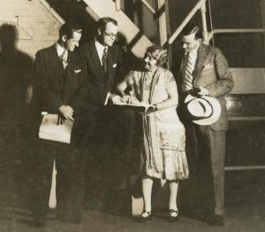 Renée Harris backstage at the Hudson discussing her play Blood Money (1927)
